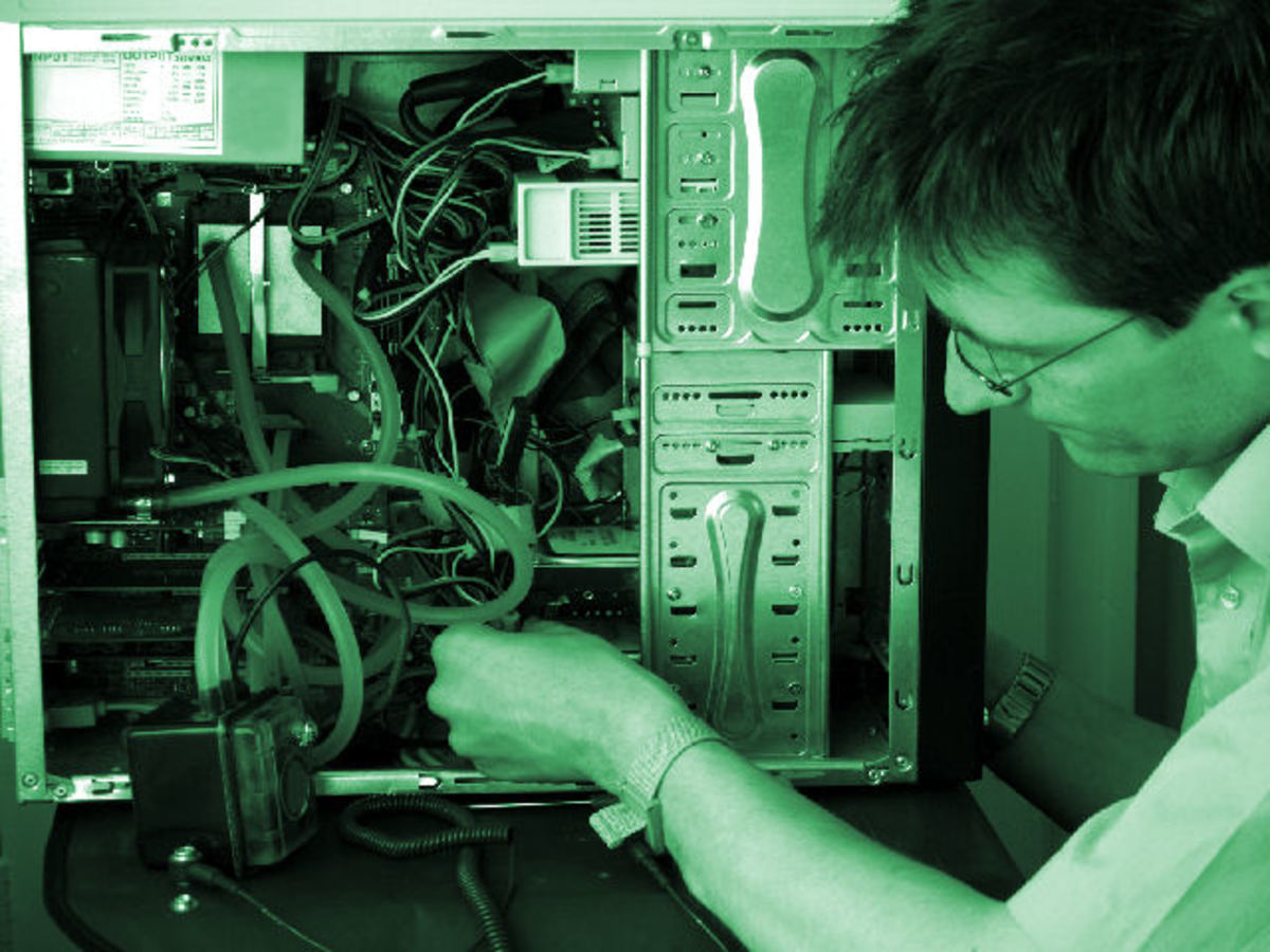 A desktop support engineer troubleshooting a computer.