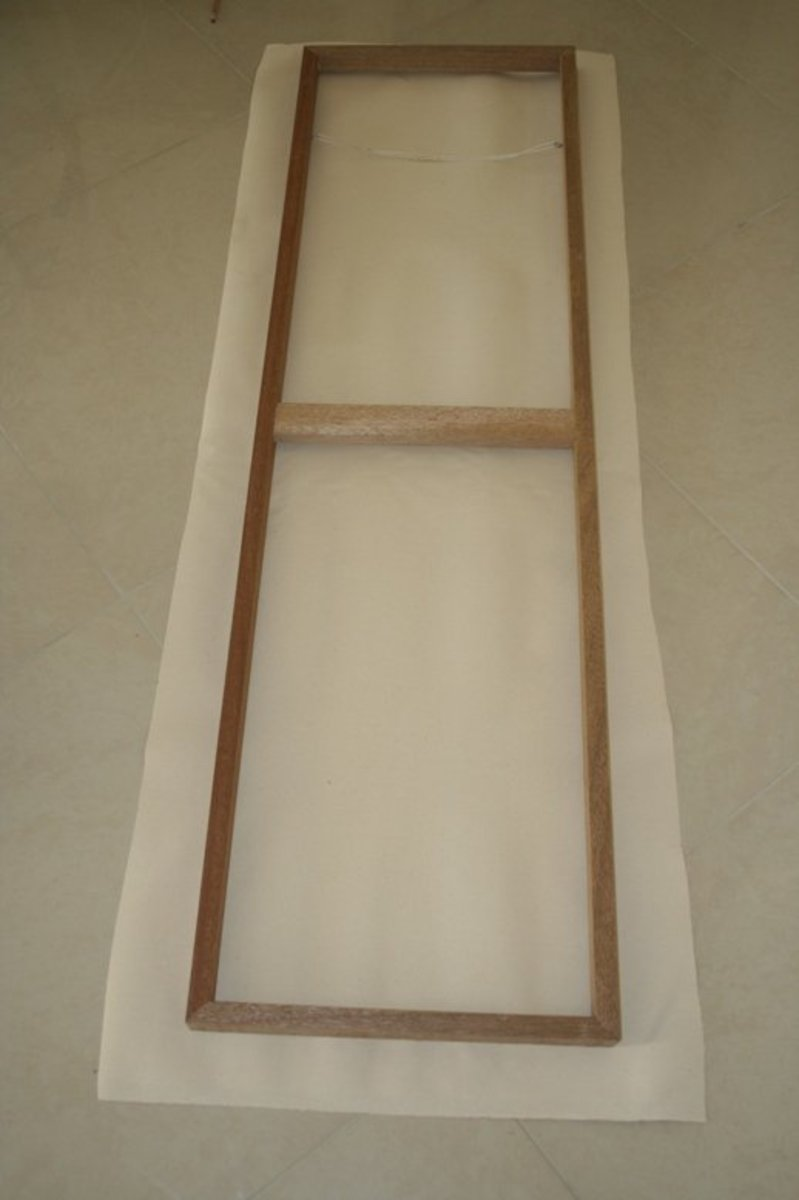 Make sure the canvas is big enough to fit all they way round the sides and onto the back of the frame.
