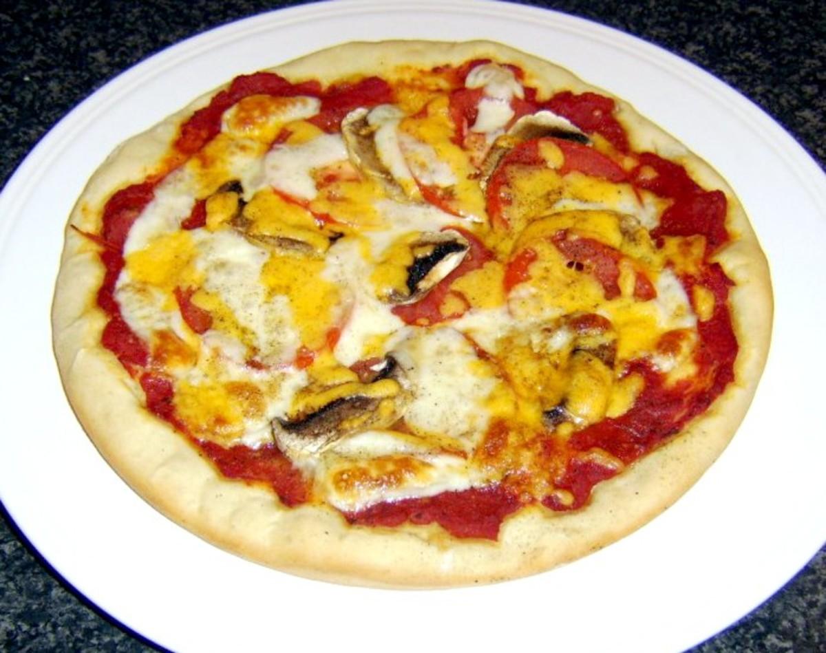 Homemade tomato and mushroom pizza