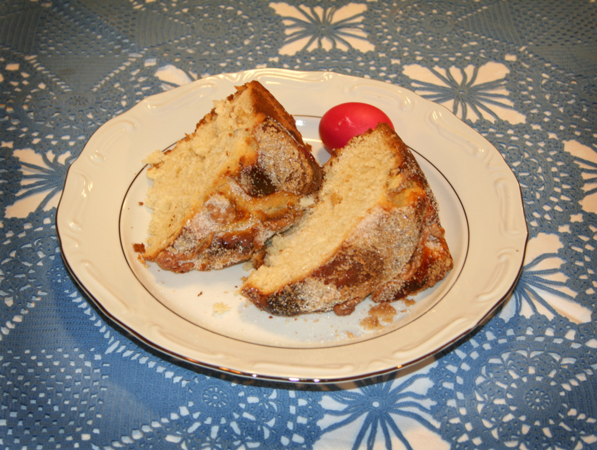 Although this is Bulgarian Easter Bread, it is quite similar to how the Croatian bread looks when it's cut into wedges and arranged on a plate.  A hard-boiled Easter egg is added on the side as a garnish.
