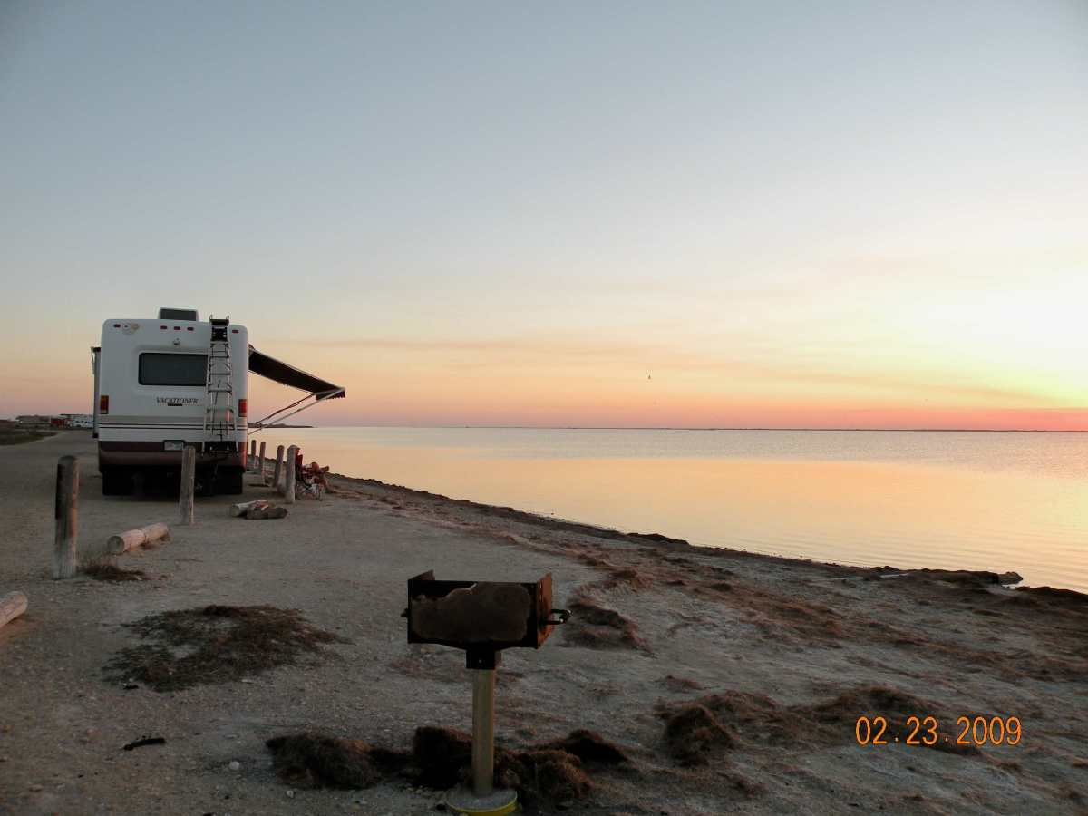 Campsite at Bird Basin, Padre Island National Seashore with a serene view of the sunset on Laguna Madre.