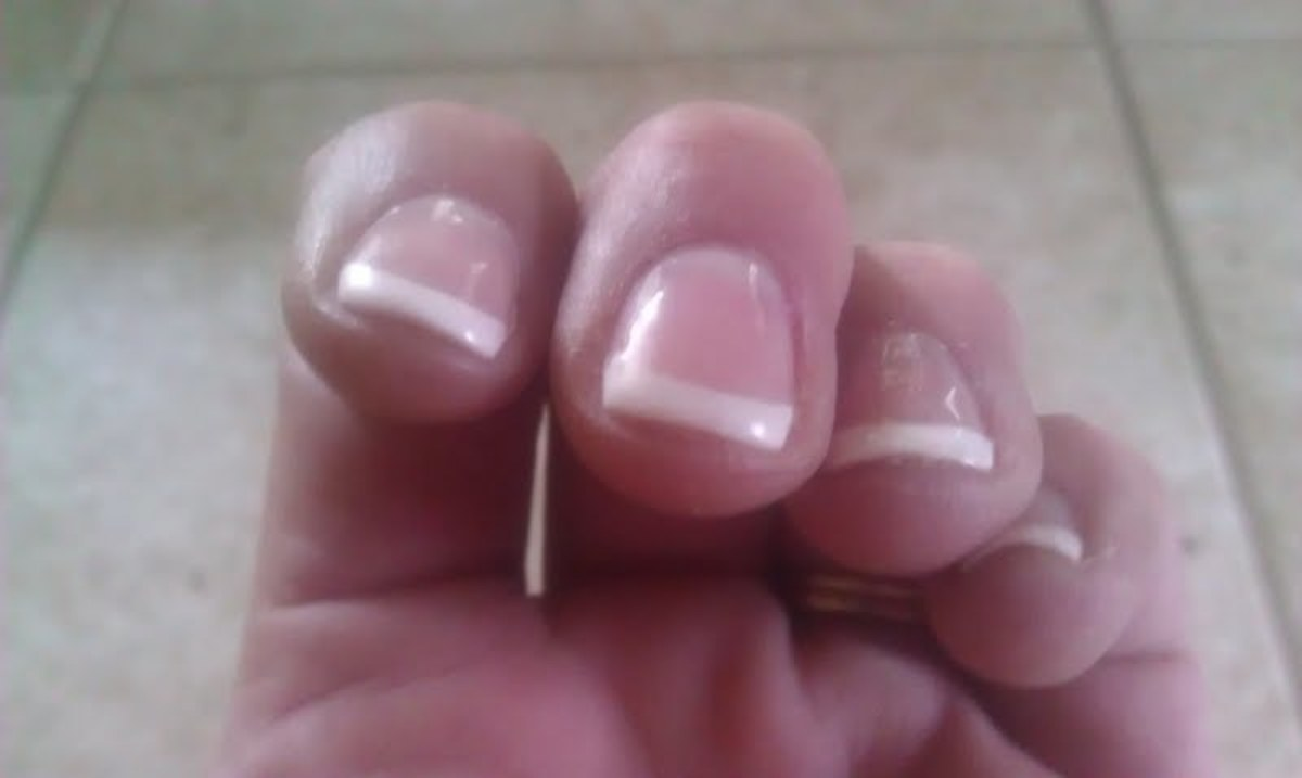 Closeup of a shellac french tip manicure