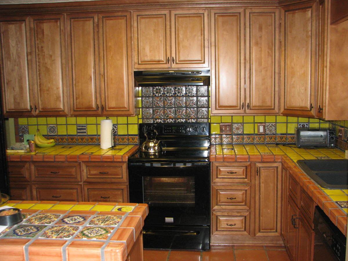 Decide how you want to use decorative tiles: borders, scattered, or in solid blocks.  We used all three in this kitchen.