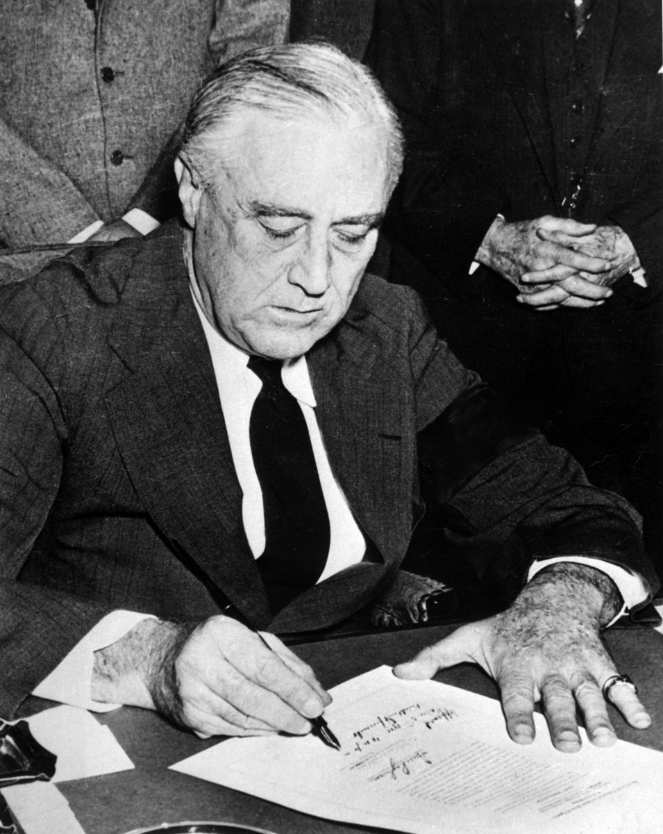 President Franklin Roosevelt signing a declaration of war against Japan on December 8th, 1941. The declaration officially brought the United States into World War II.