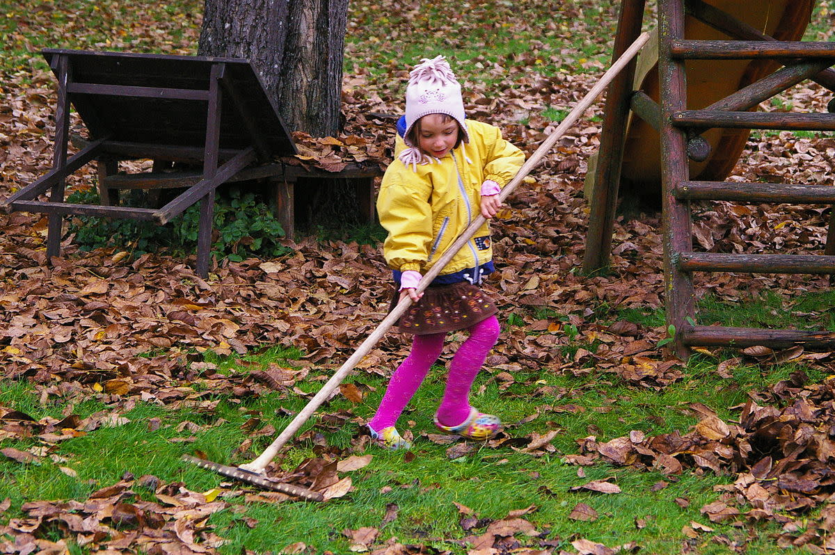 Kids enjoy raking leaves and it can be the start of a lifelong love of gardening.