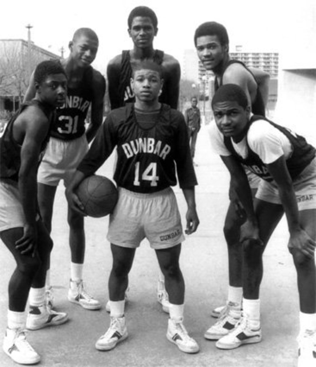 1984 Dunbar Poets (from left to right)  Darryl Wood, Reggie Lewis, Reggie Williams, Tim Dawson, Jerry White. (Center) Muggsy Bouges