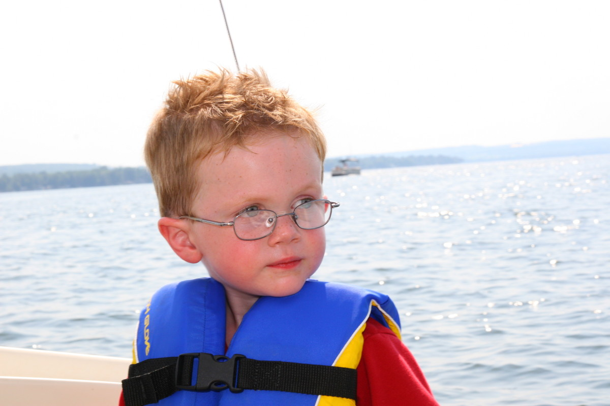 Life jackets are a must when sailing with children: be sure the jackets fit well by testing in a pool prior to embarking on a sailing adventure.