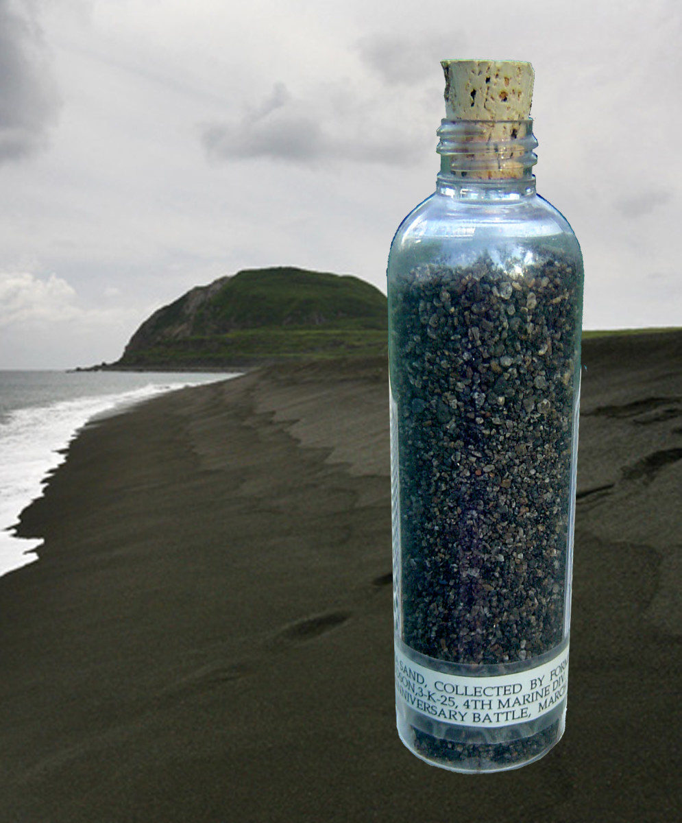 A vial of sand from the beach at Iwo Jima.  You can see that Mt. Suribachi is a bit greener now than during the battle.
