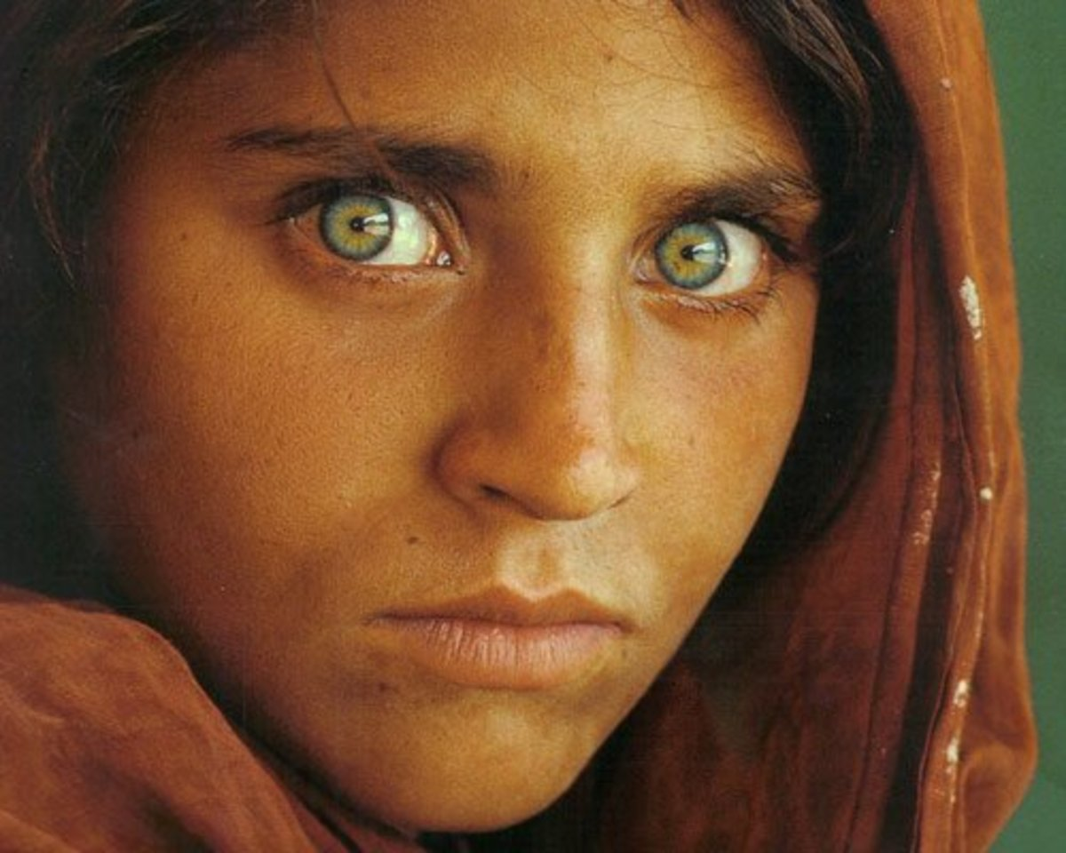 "The famous ""Afghan Girl"" National Geographic cover featured Sharbat Gula, a young woman with naturally green eyes."