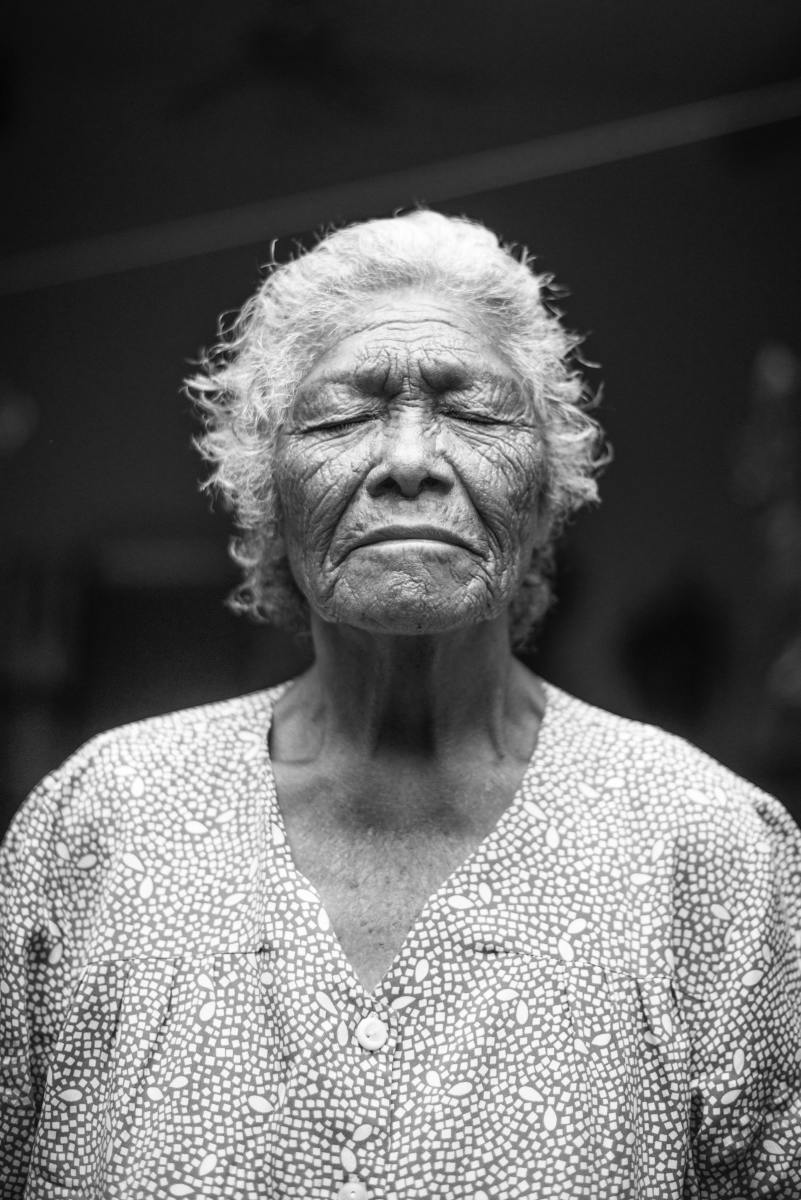 'Old Woman Closing Her Eyes' by Cristian Newman on Unsplash