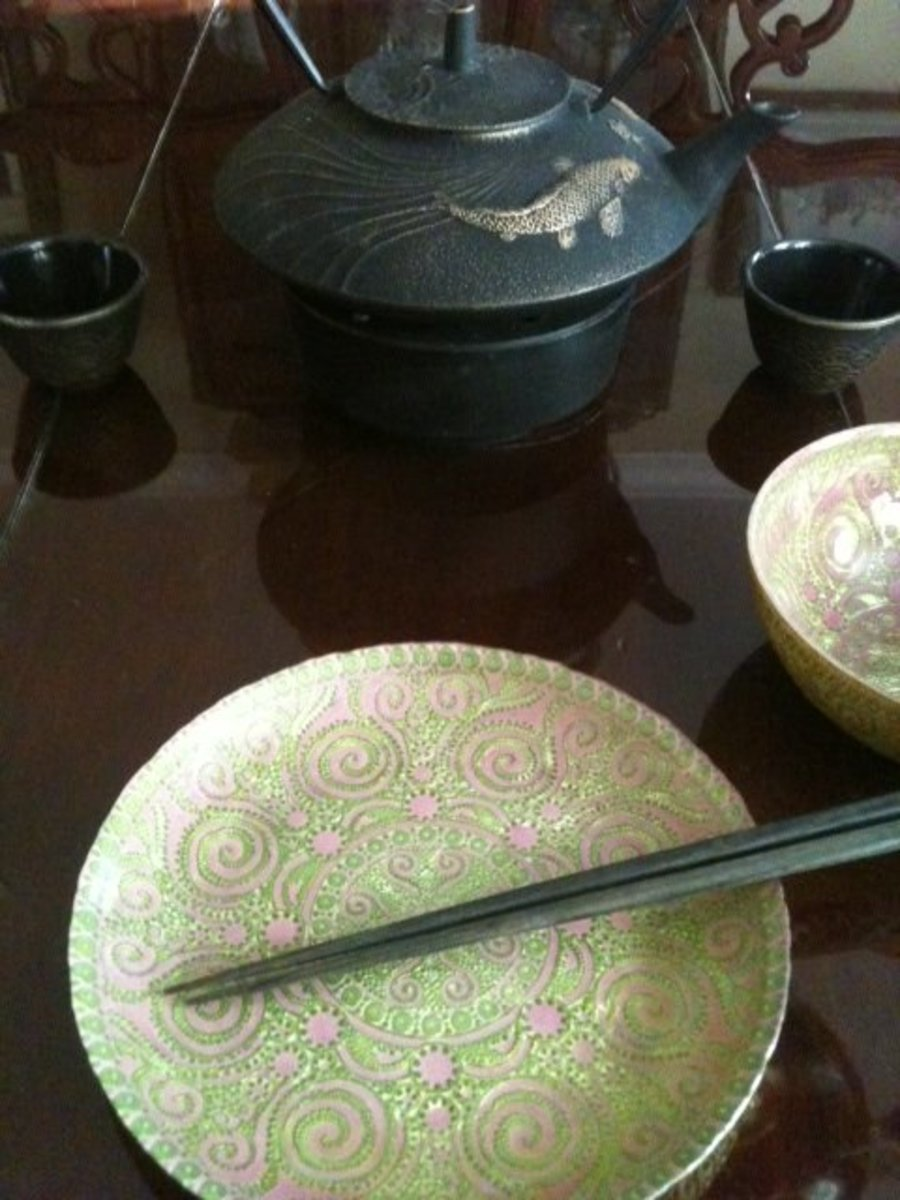 A pair of chopsticks on a lovely plate.