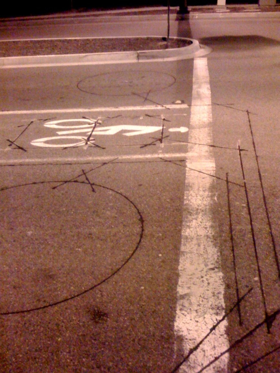 A detector loop buried in the pavement sends signals to the traffic control system.