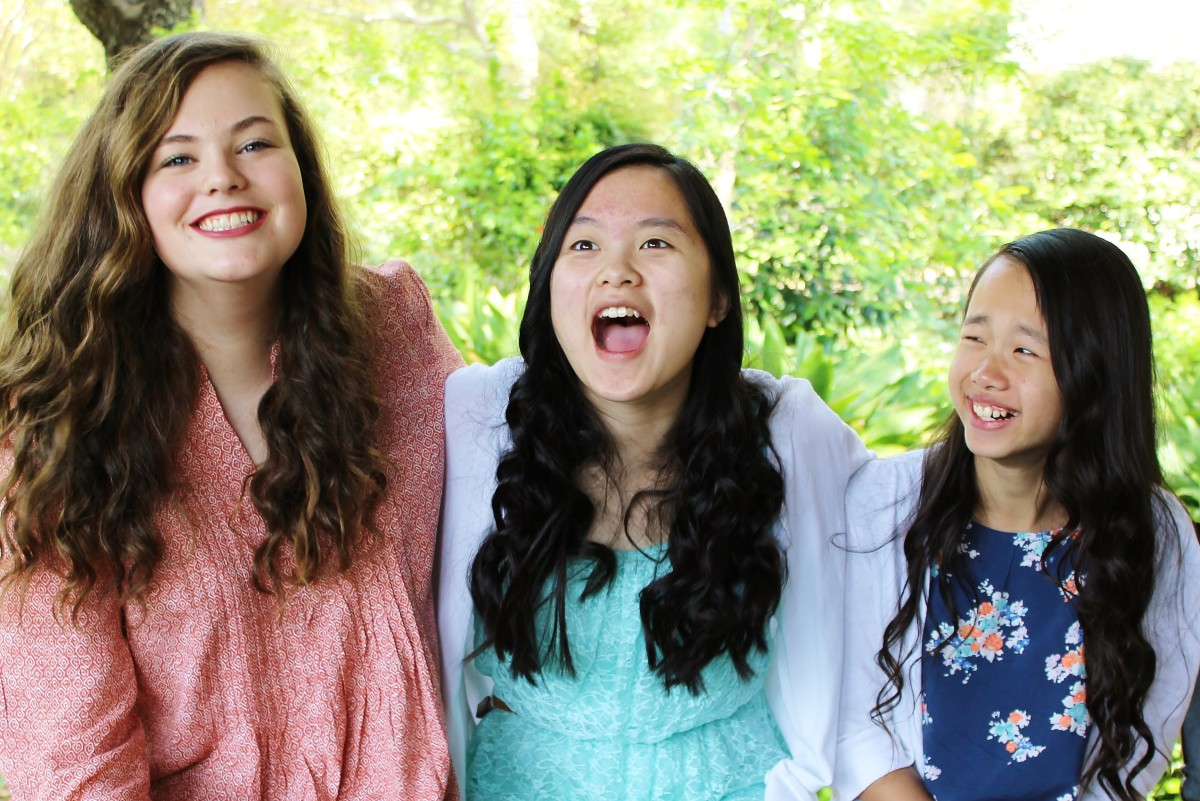 Our three youngest children at a recent photo shoot.  You can tell we are having fun!
