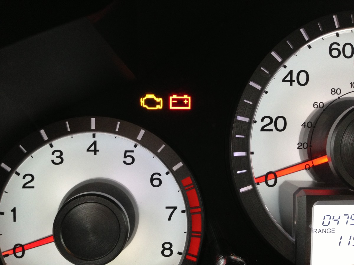 """Check engine"" light:  at left, with a yellow engine-shaped icon (2011 Honda Pilot)"
