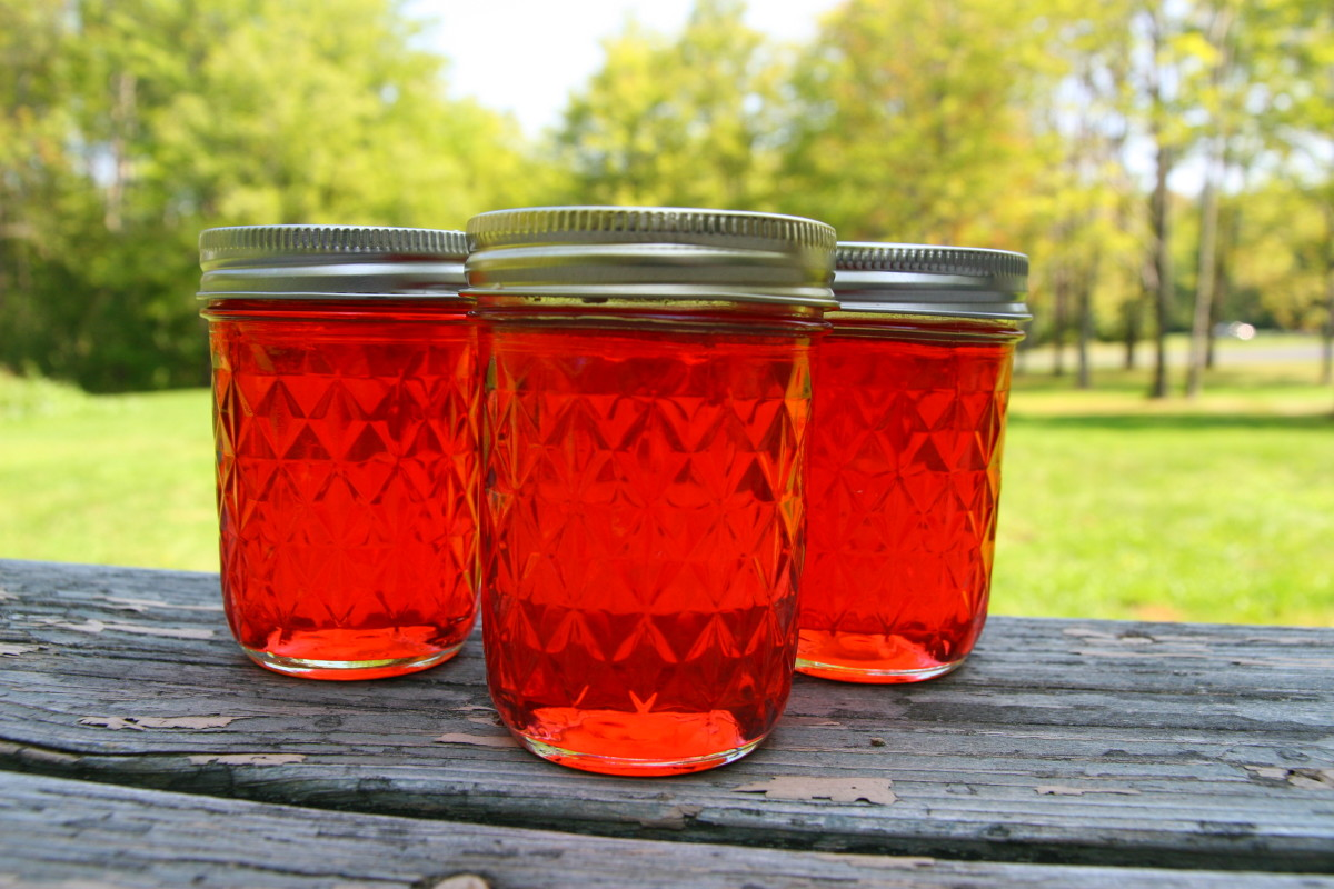 Candy Apple Jelly is beautiful and tastes like baked cinnamon apples. This is an excellent homemade gift during the holiday season!