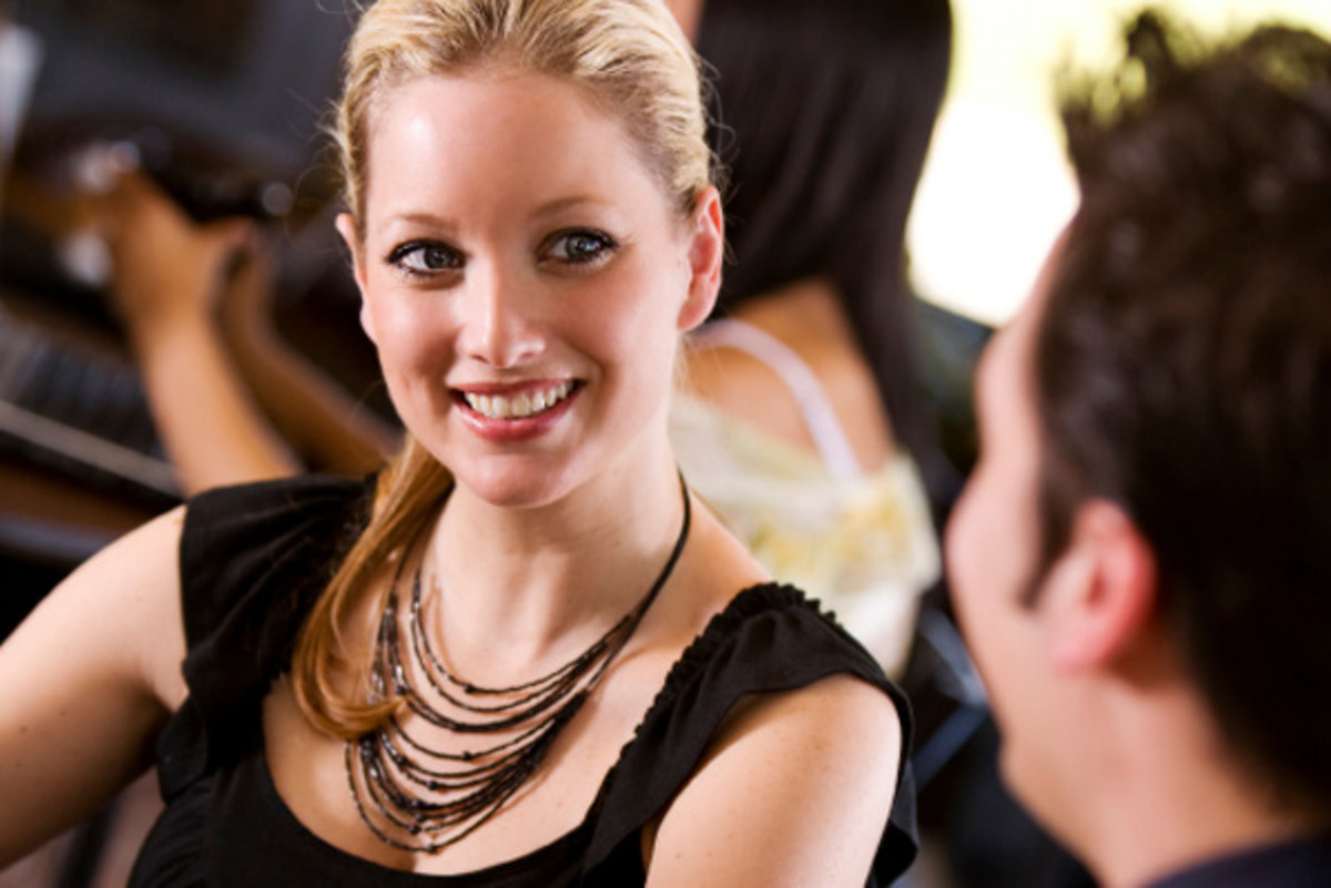 The Body Language of Attraction: Signs to Watch