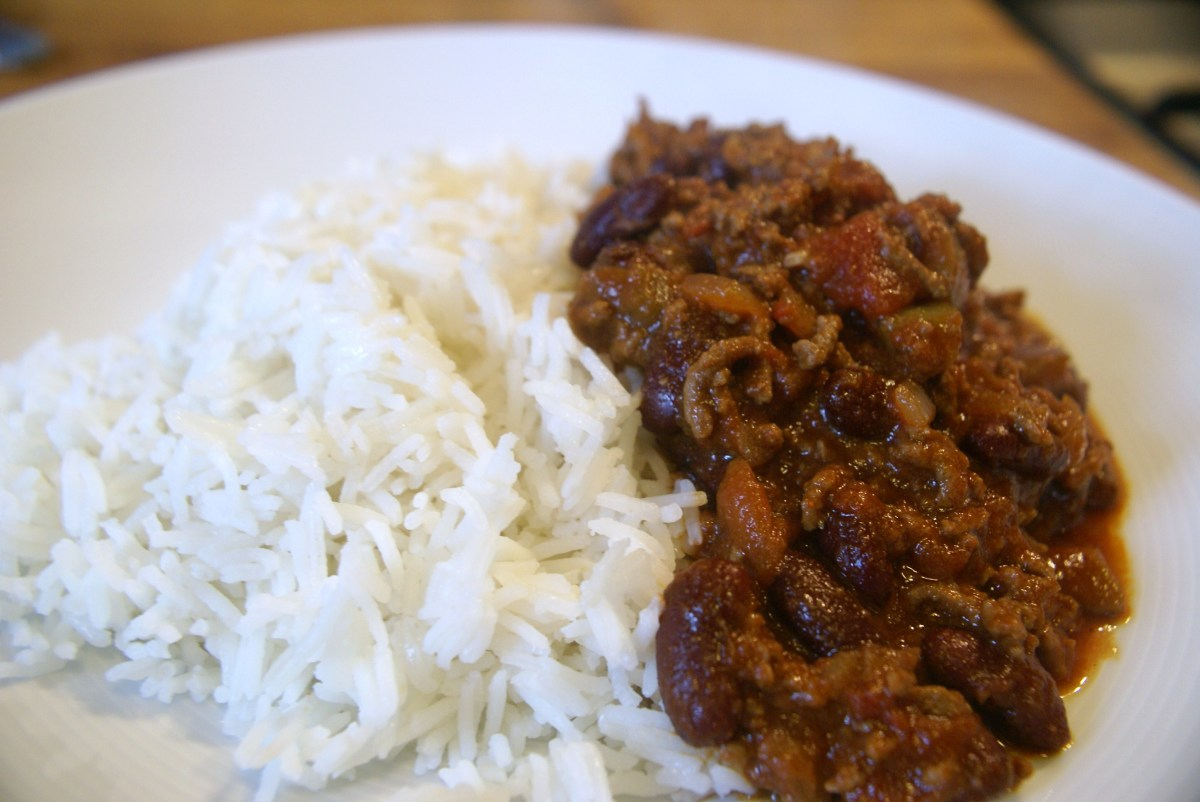 The completed chilli con carne served over rice.