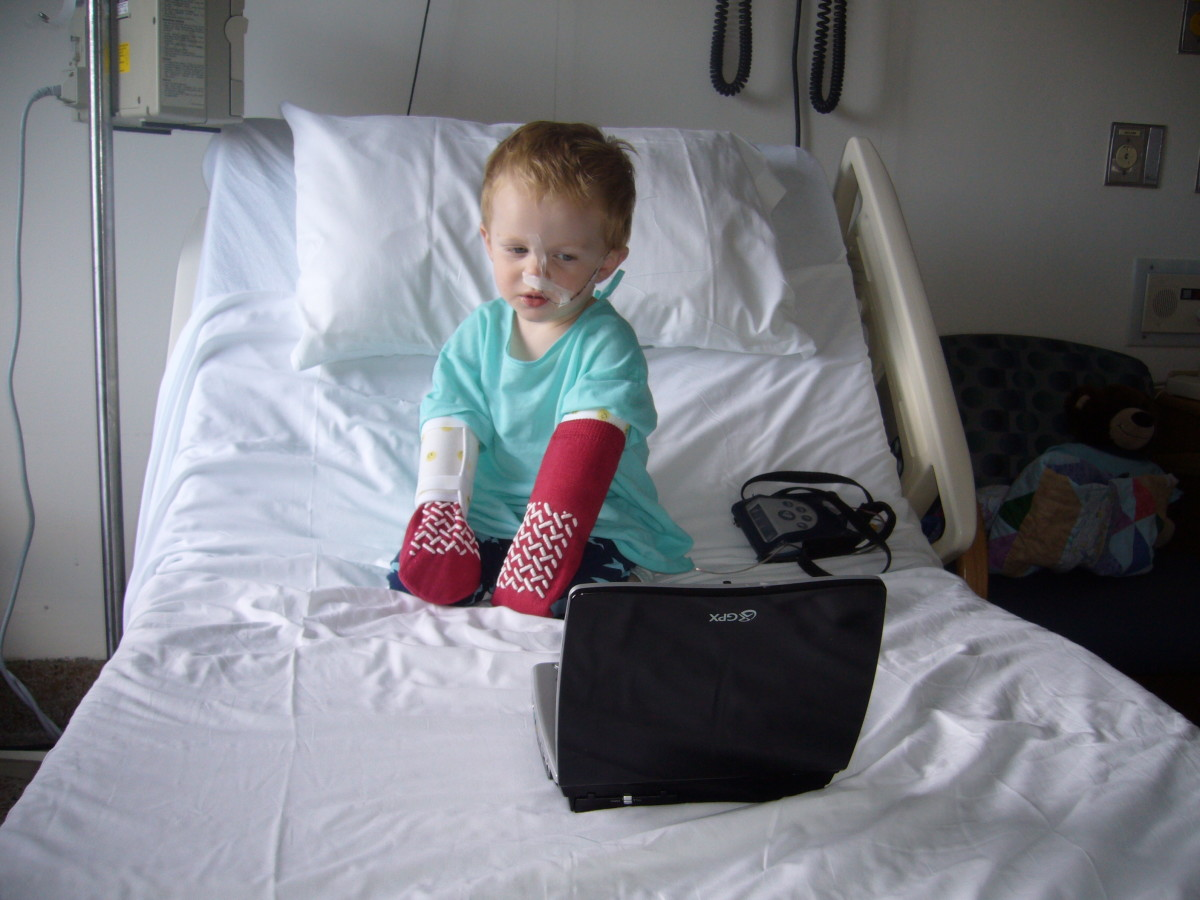 "Arm bands called ""no-no's"" and socks were used to prevent our son from pulling out the probe. A portable DVD player kept him entertained during the hospital stay."