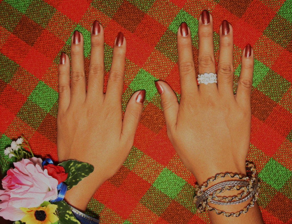 A pair of hands, well taken care of, with manicured nails for JS Prom party.