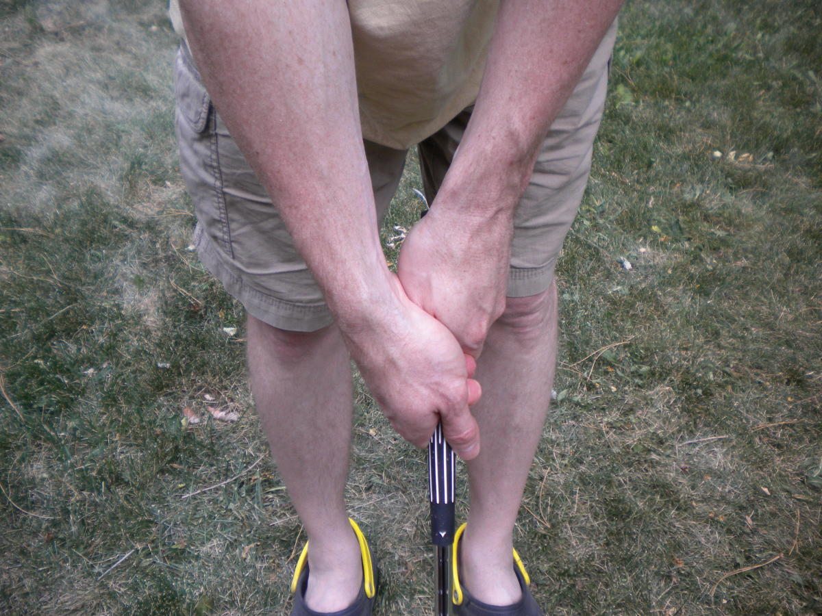 A solid golf grip with v's pointing downward. Right hand could stand to turn toward the club just a bit.