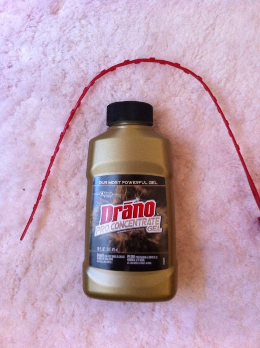 Some Drano comes with an 18 inch plastic snake that has hooks to remove a clog near the top of the drain.