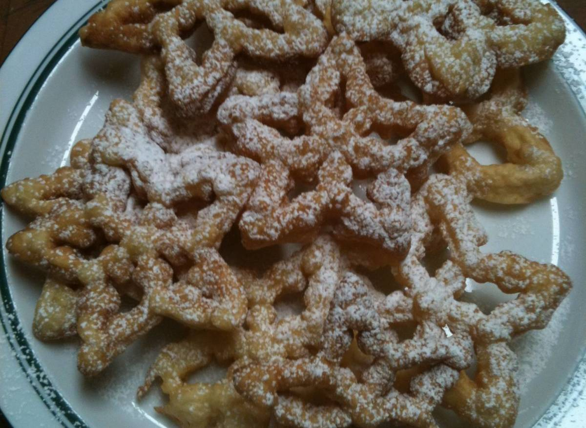 Yummy rose cookies dusted with confectioner's sugar