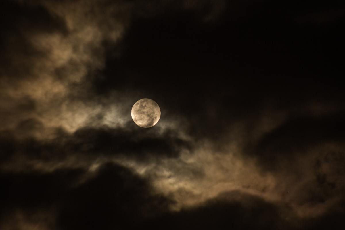 Even through the veil of a cloudy sky, the full Moon is stunning.