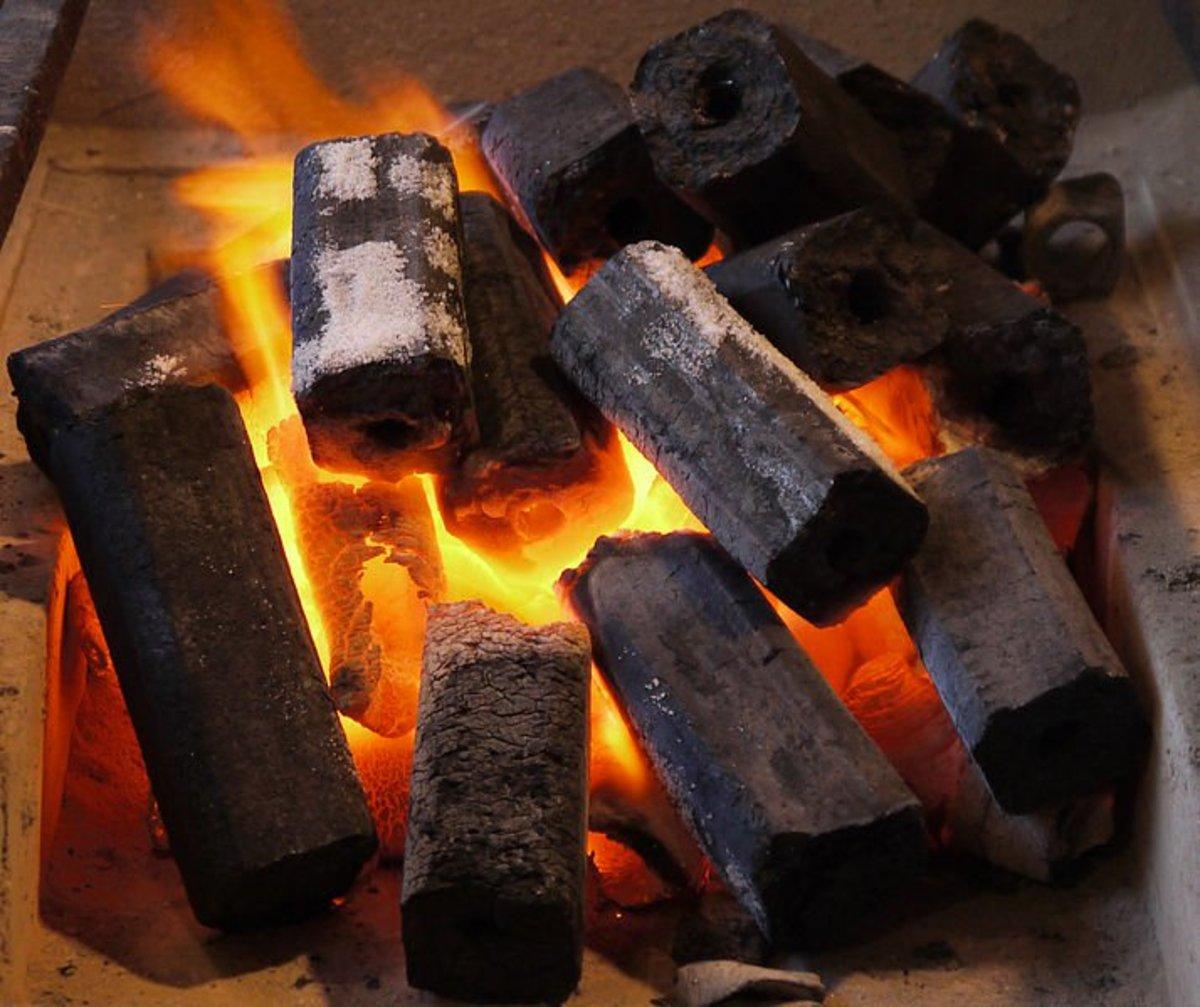 How to Make Charcoal Briquettes - Charcoal Briquettes Burning. Image credit:DryPot, Wikimedia Commons.