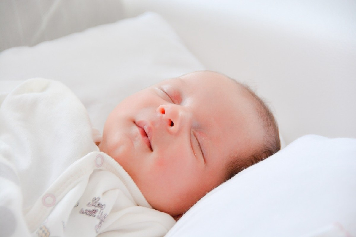 Babies pick up oral bacteria from their caregivers via activities such as being kissed.