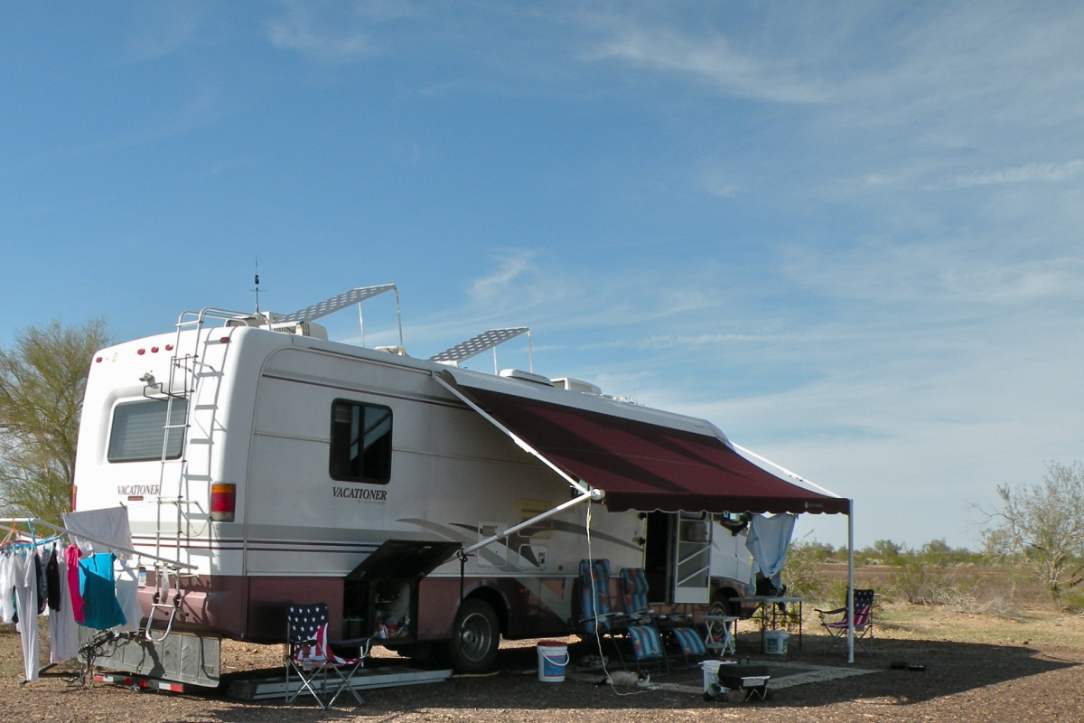 "Camping is Free in the 14-day BLM area on Plomosa Road near Quartzsite with solar panels up on the roof and wash on the ""solar"" dryer."