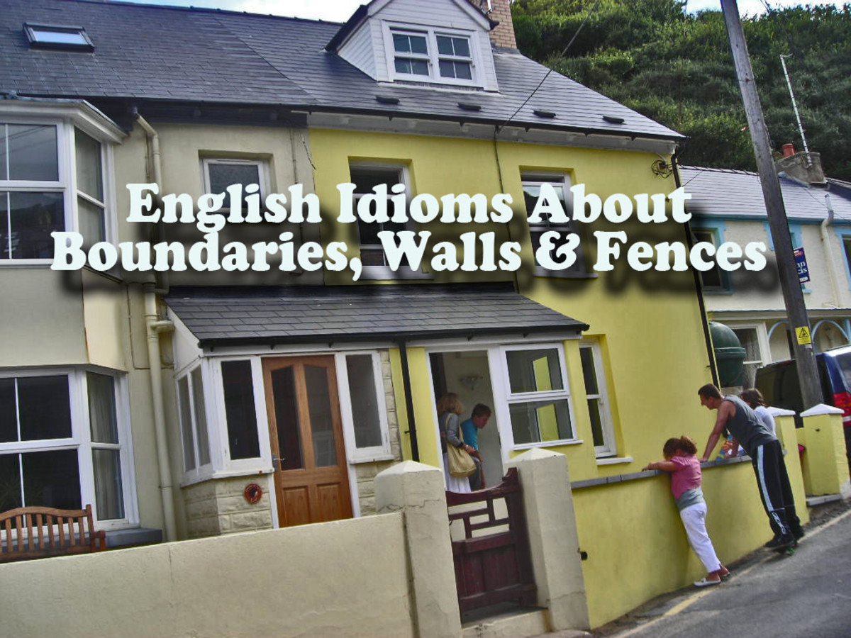 The front walls of these Welsh cottages form the boundary between public land (the pavement) and private land (the cottage and garden)