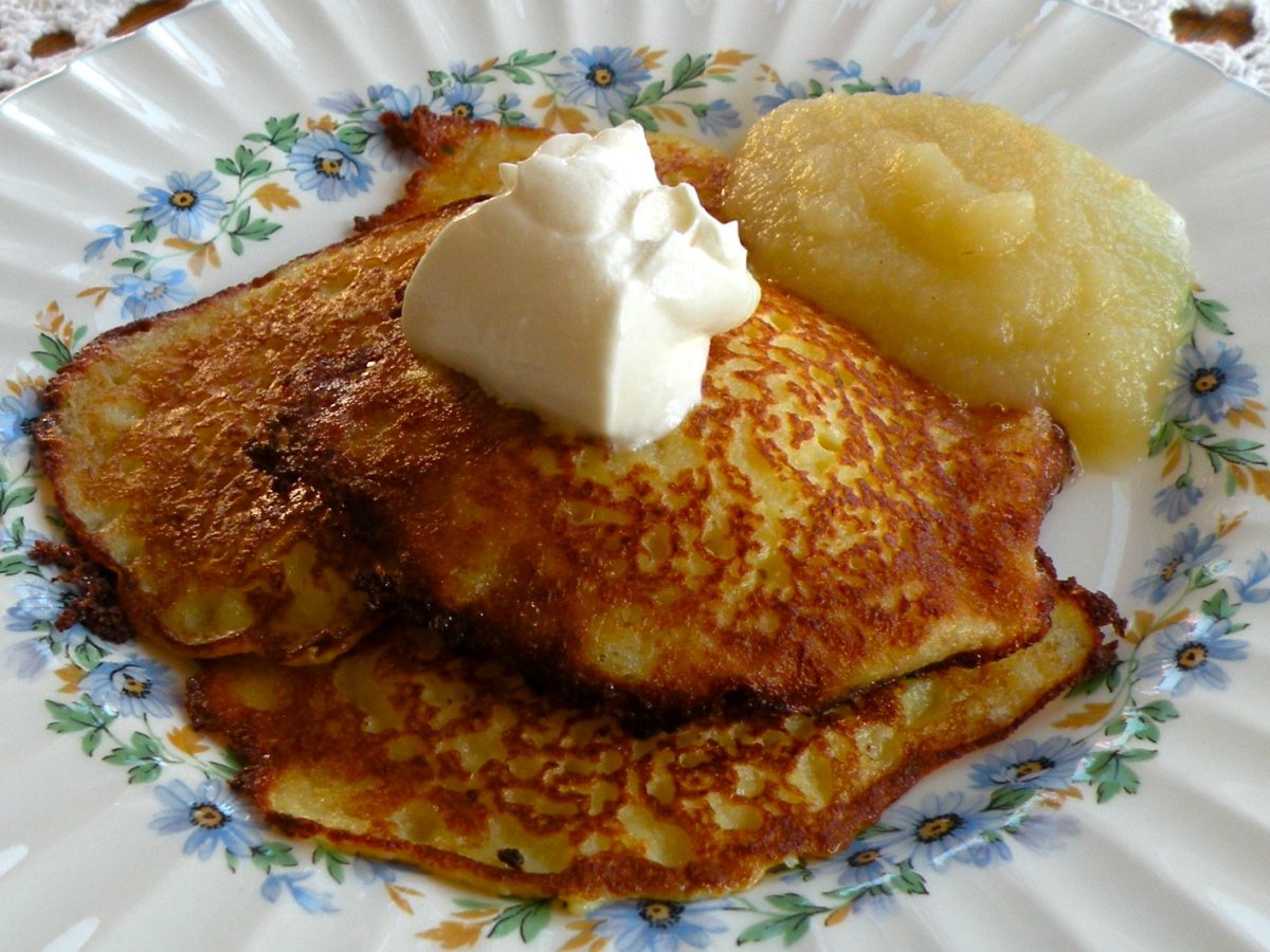 Freshly prepared potato pancakes served with applesauce and sour cream.