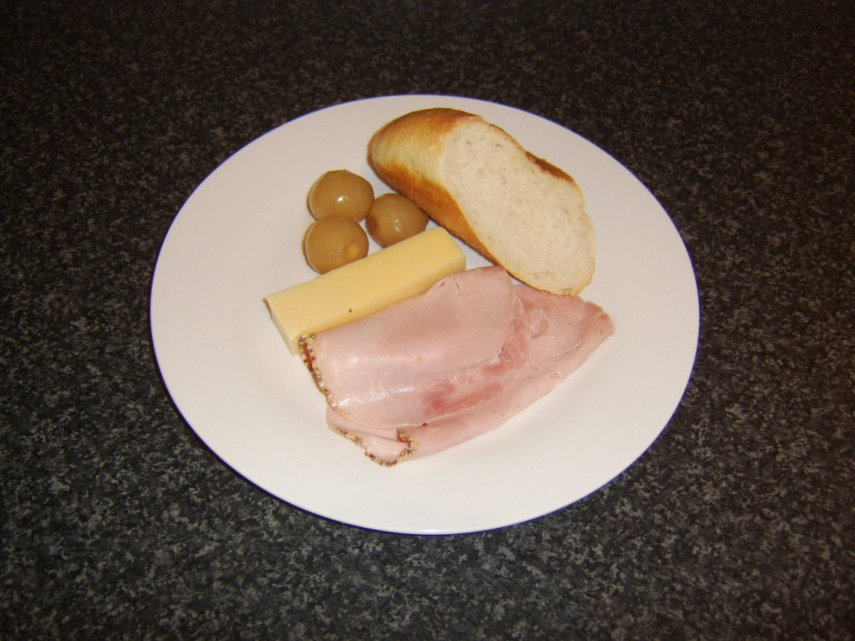 Homemade pickled onions with bread, ham and cheese.