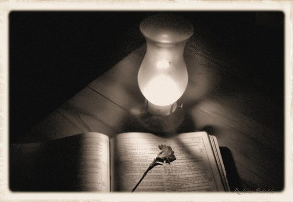 Bible by lantern light.