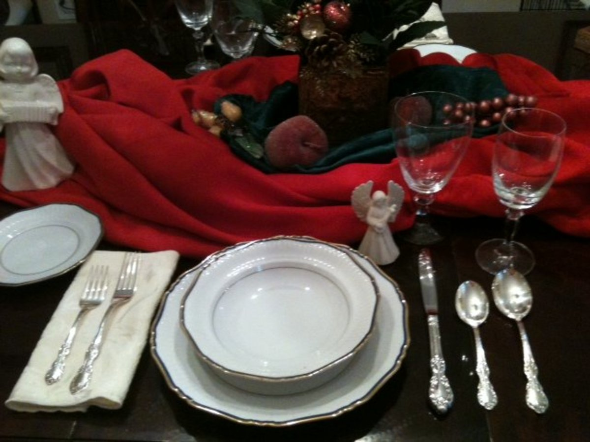 Proper table setting. Added embellishments make it a holiday setting.