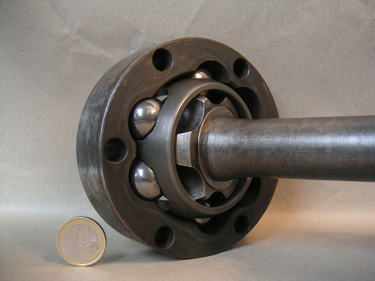 A CV joint lets an axle bend while it is spinning