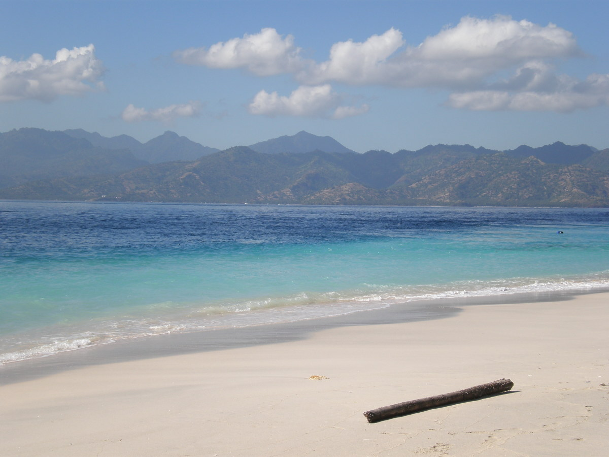 Impossible blue-turquoise sea and white soft sand of Gili Trawangan, Indonesia.
