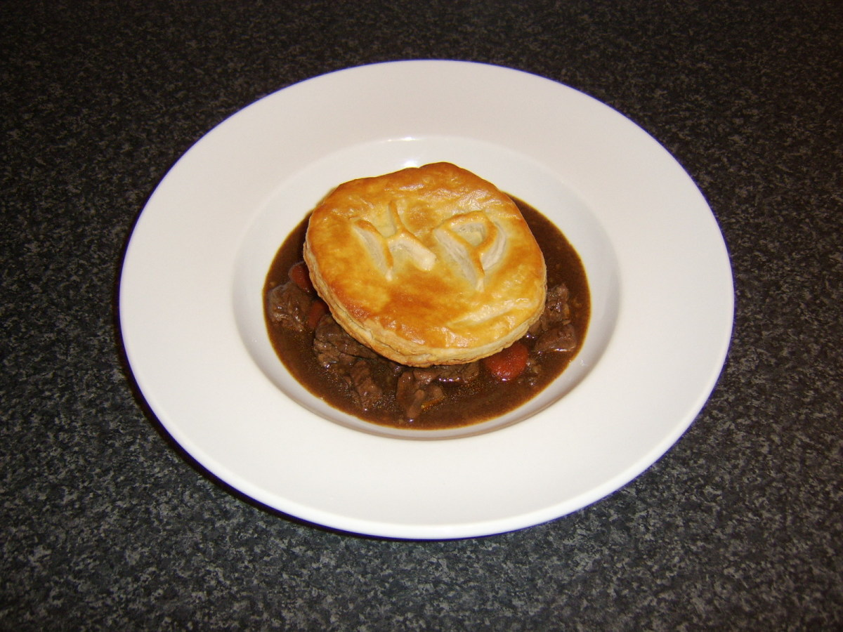 This beef steak and kidney stew with HP Sauce and a monogrammed puff pastry disc is just one of the beef stew recipes to be found on this page