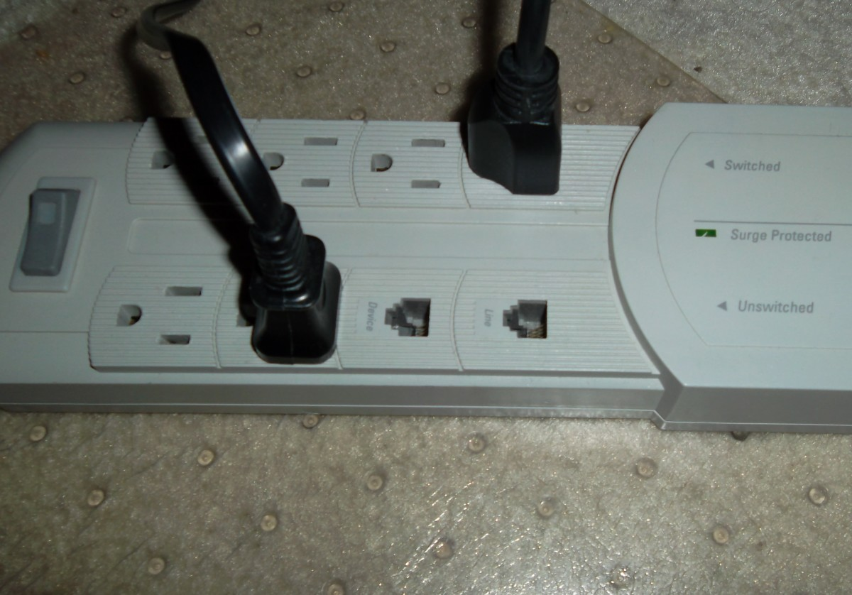 By plugging electronics into power strips and  switching off the strip, energy can be saved, especially in areas with T.V.s and other home entertainment electronics.