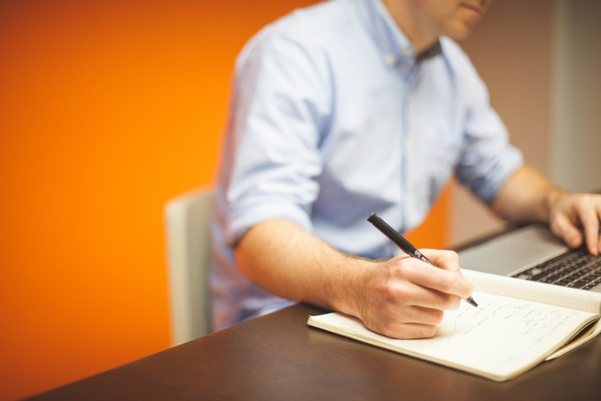 Jotting down notes while writing an employee performance review will help ensure you don't miss a thing.