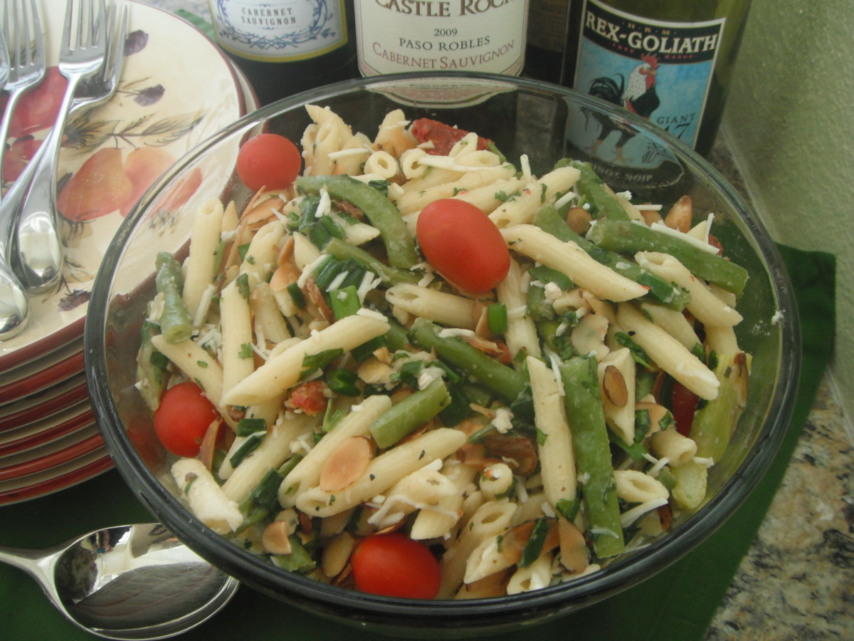 "The ""Best Pasta Salad Ever,"" ready and waiting for guests at the buffet table."