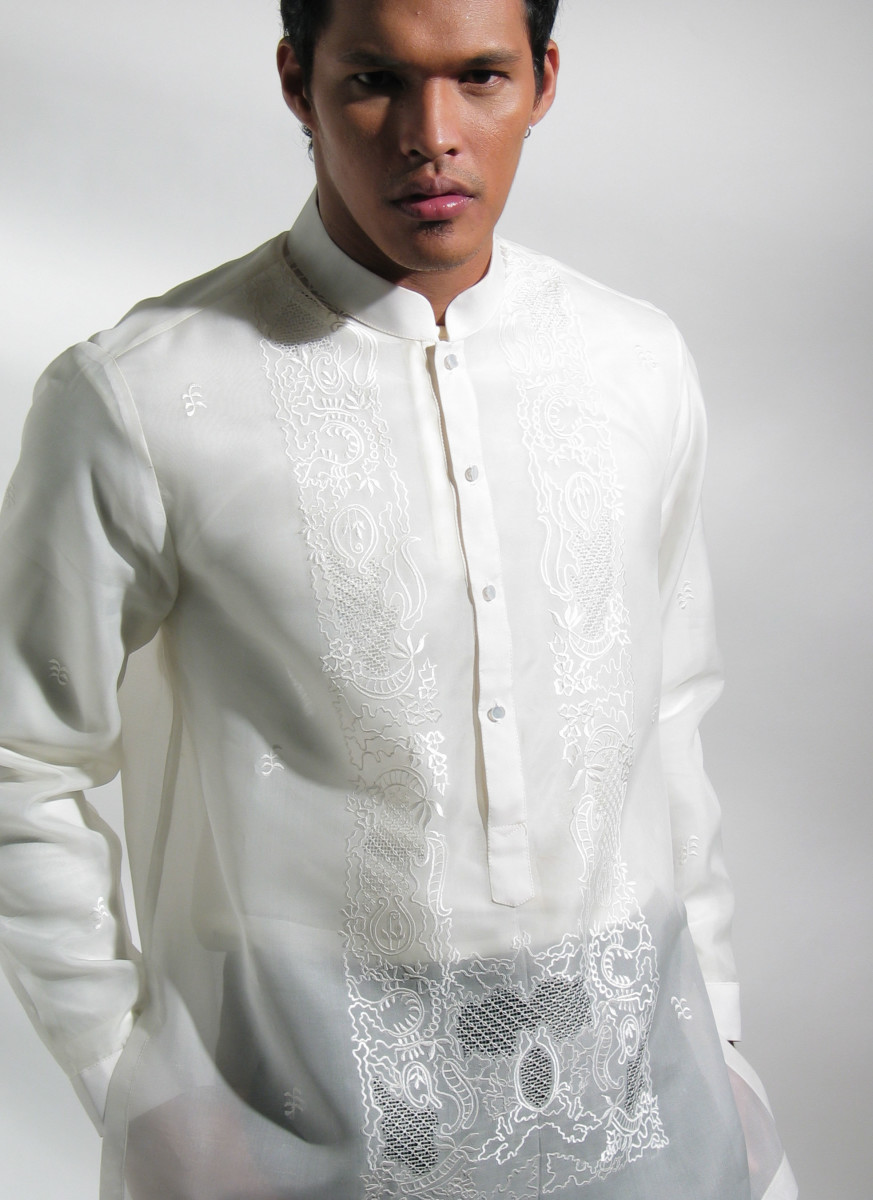 A Filipino man wearing an embroidered Barong Tagalog, the formal shirt common at Filipino weddings.