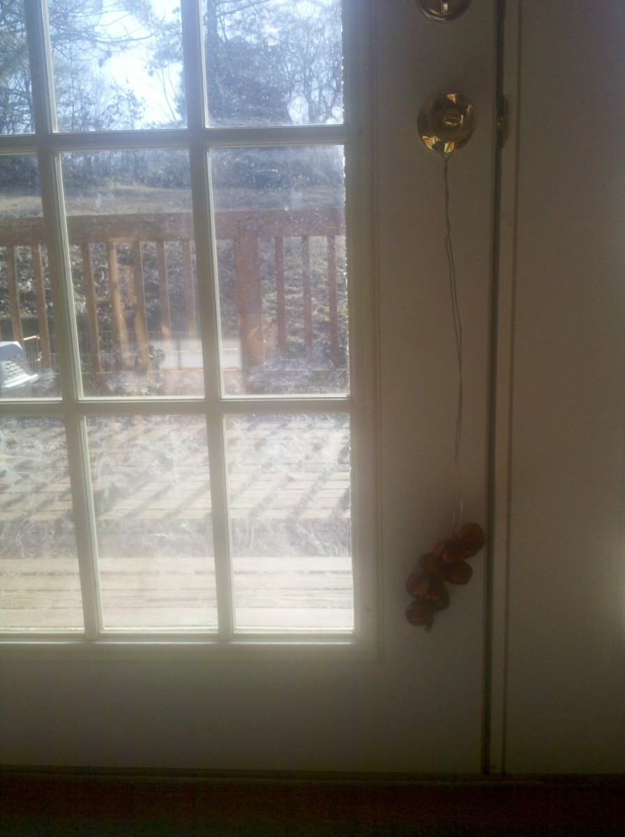 Hang bells low off a doorknob as a notification system.