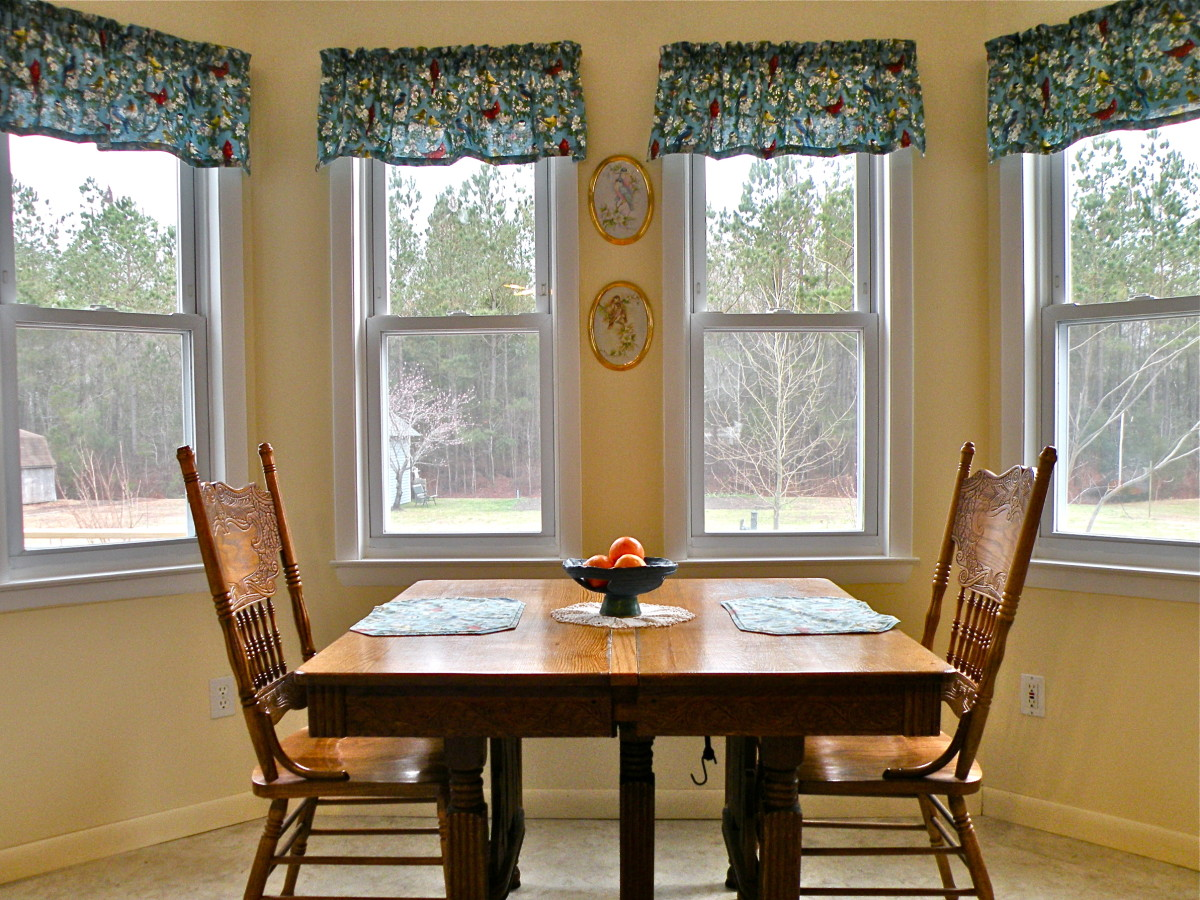 Dining area looks out over backyard. Privacy curtains are not really necessary, but there are roll-up shades to block sun when needed.