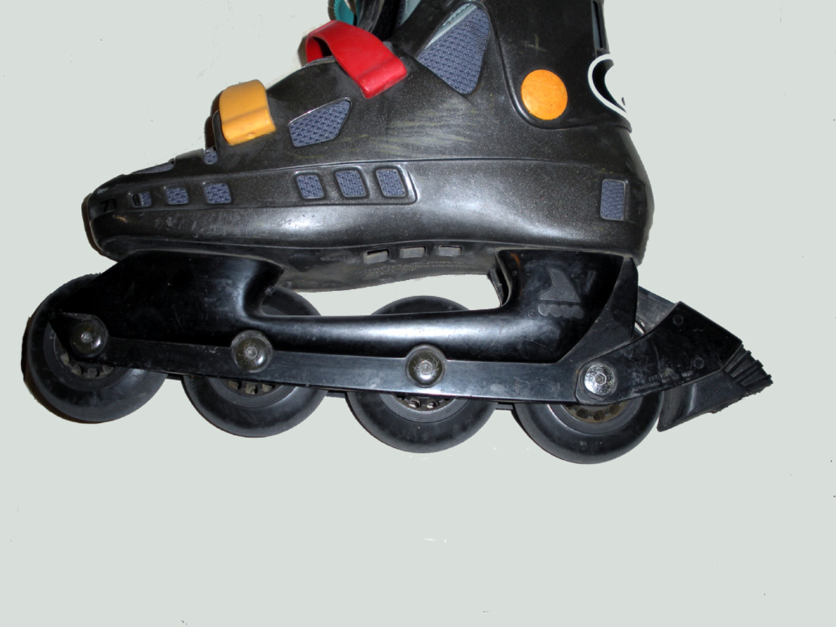 In-line skate profile; the block of rubber at the heel is the brake