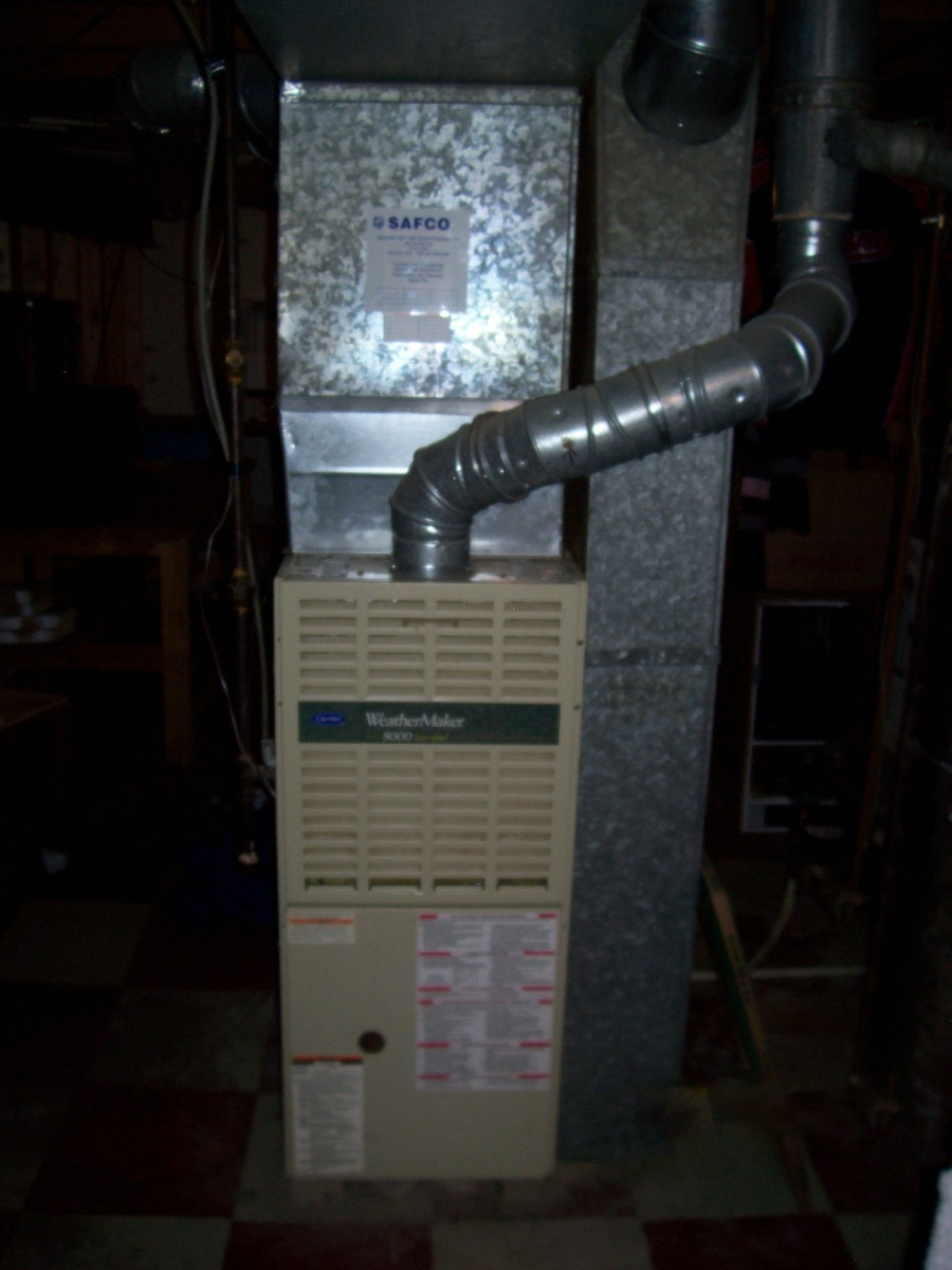 Notice the metal flu (chimney). This is common for furnaces that are 80% or less efficient. High efficiency units (90% and higher) will usually have PVC (plastic) flu pipes.