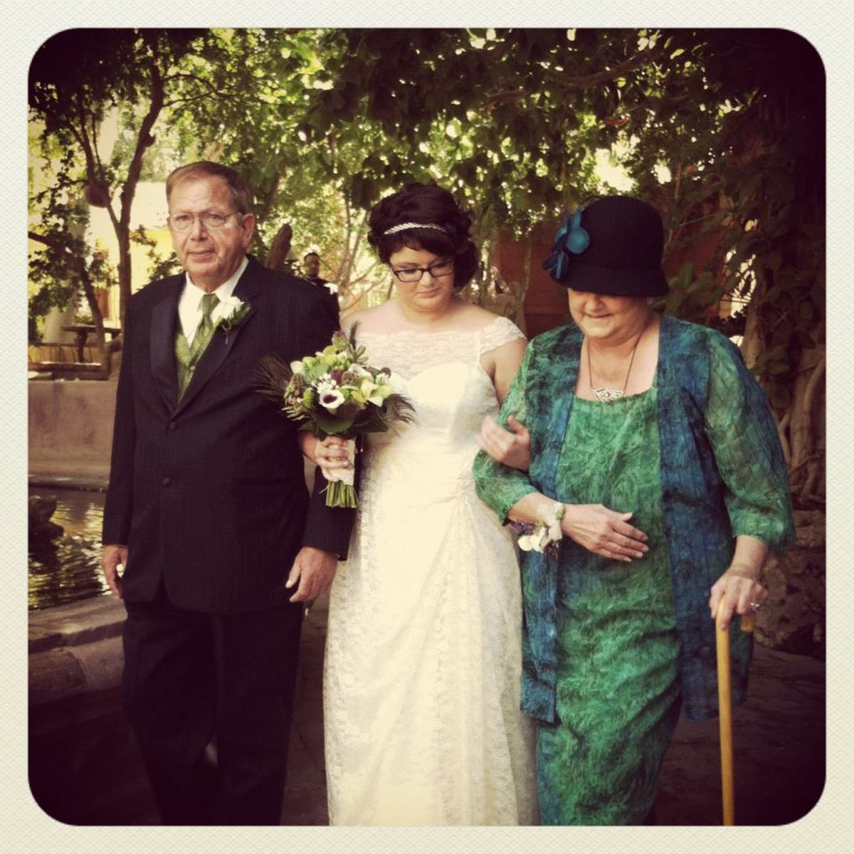 My father and mother walking me down the aisle.