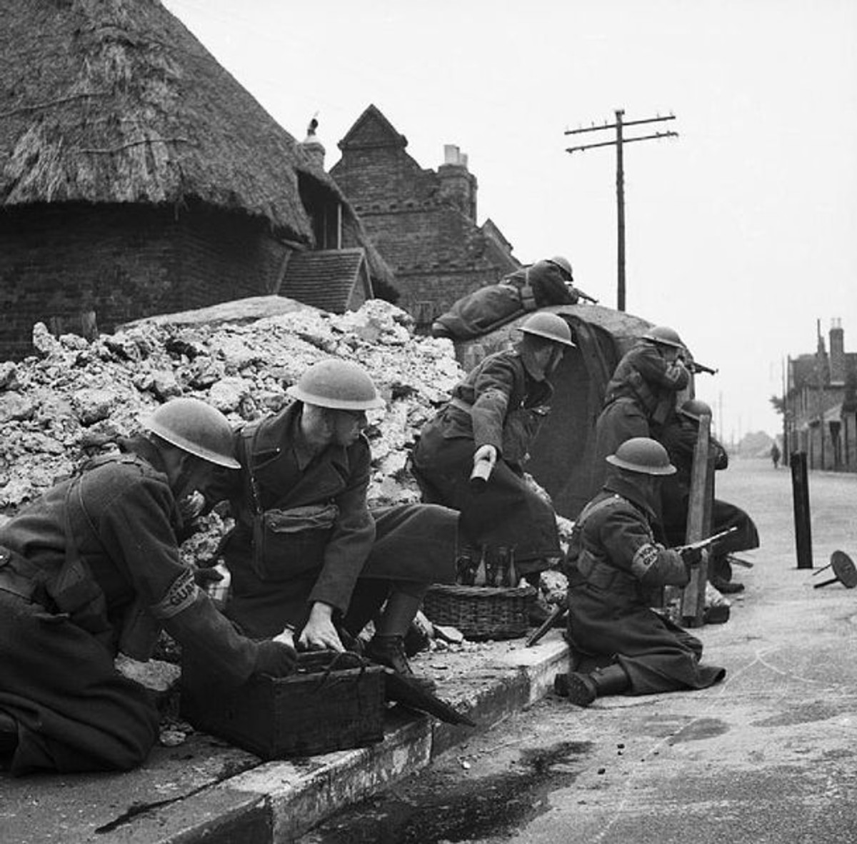 Home Guard soldiers training to defend a street with Molotov cocktails. Circa March 1941.