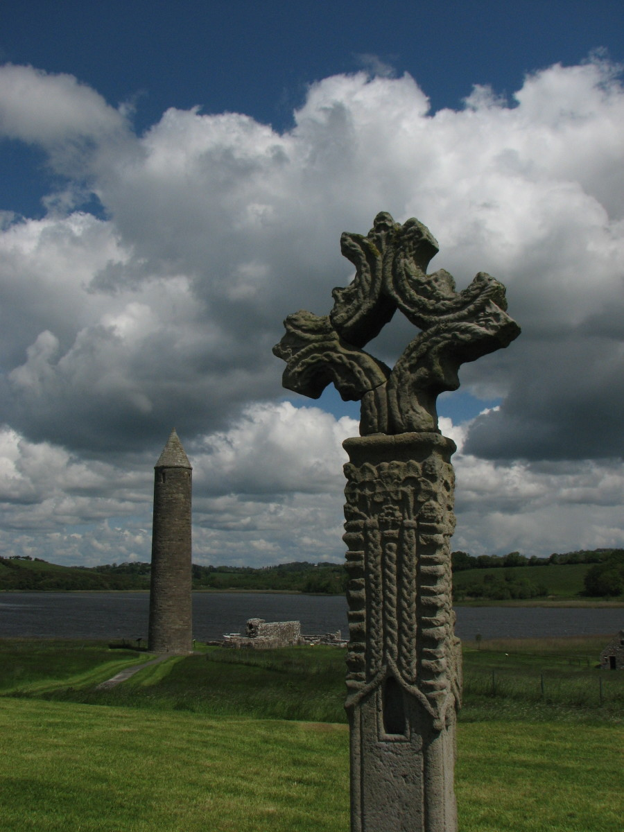 The abbey at Devenish island, Ireland, had a typical round tower (seen in the distance). Monaks would have climbed up to the top room in the tower by ladder and then pulled up the ladder leaving them and their valuables high above the ground.