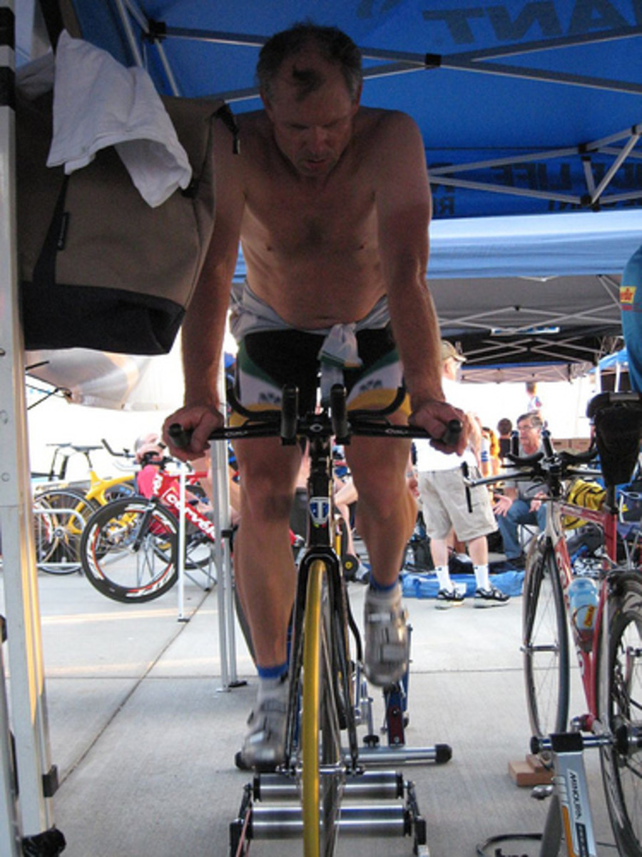 An athlete warming up for an event on bicycle rollers